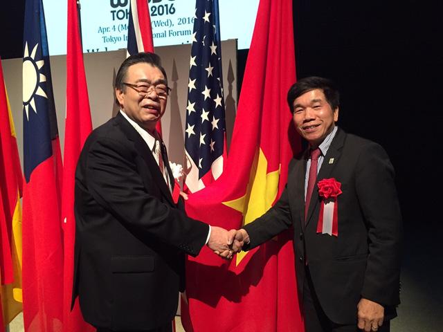 Ông Nguyễn Quốc Hiệp (bên phải) trong hội nghị Thượng đỉnh về bảo trì quốc tế tại Tokyo, Nhật Bản tháng 4 vừa qua