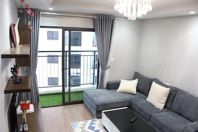 Phòng khách của căn hộ 107m2 được cư dân bố trí tinh tế.