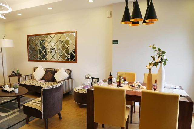 Phong cách nội thất căn hộ mẫu trang nhã, tiện nghi, sử dụng các tông màu hiện đại.
